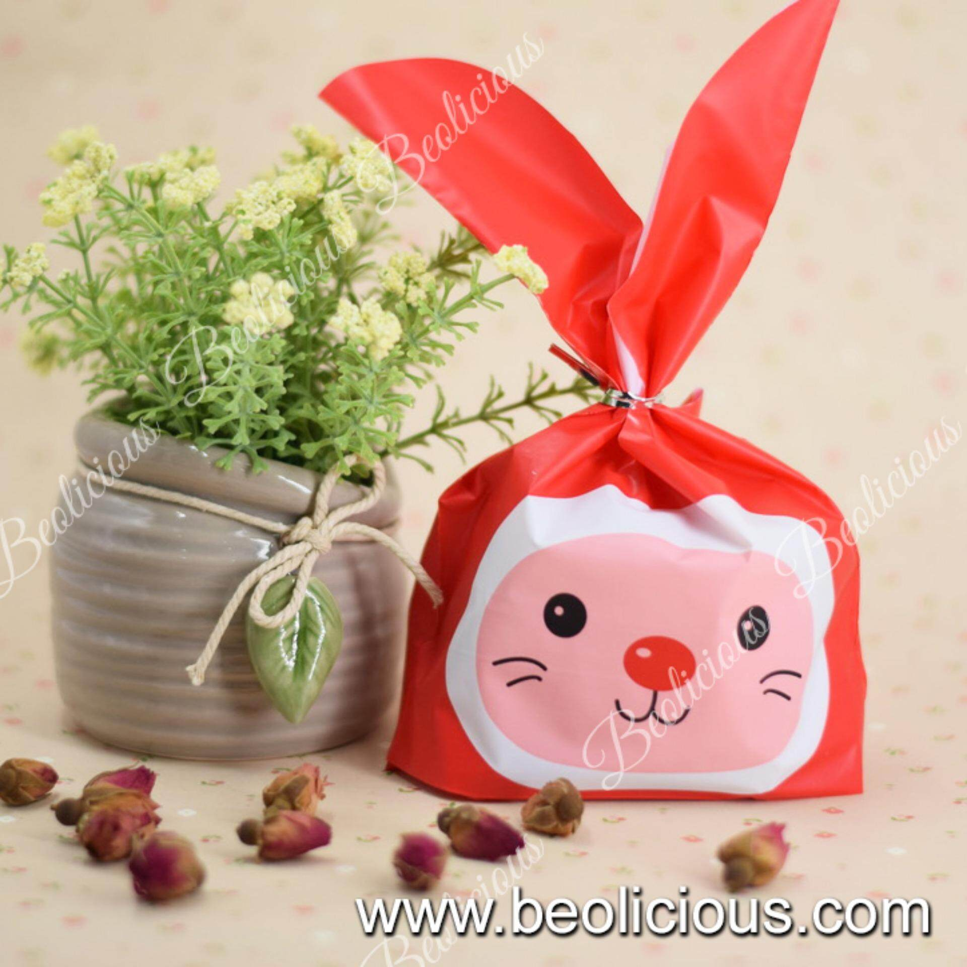 Home gift wrapping bags buy home gift wrapping bags at best 50pcs small red nose rabbit goodies bag plastic bag gift wrapper or negle