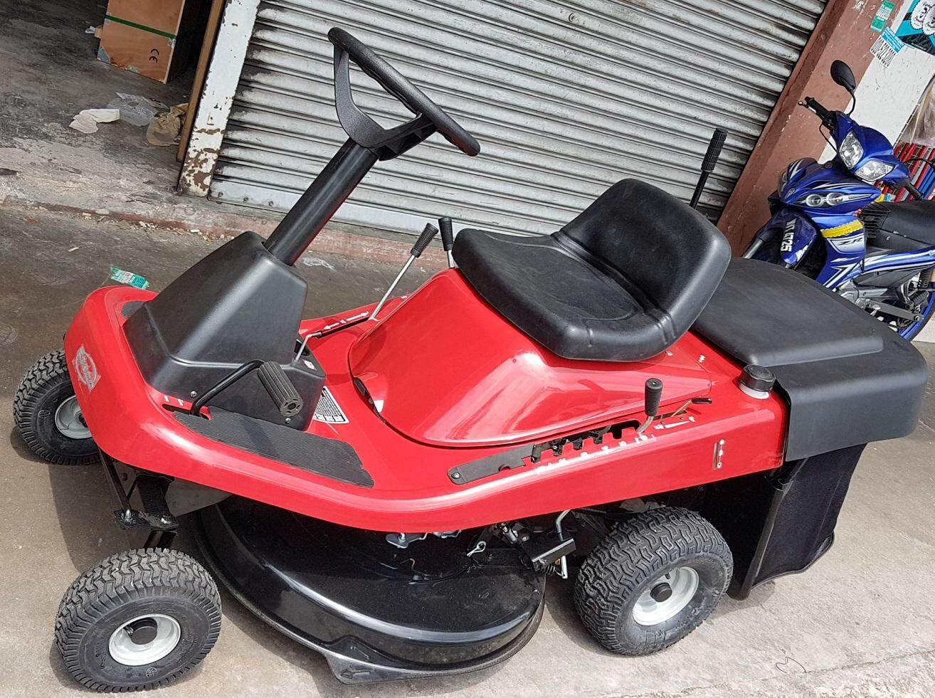 grass cut cutter cutting lawn mower ride on riding car tractor tool roll roller rolling sit truck drive driving control high low power engine slicer drill grinder floor wheel blade plate handle handling press pressure slice petrol motor tank collector