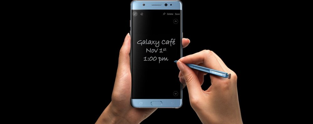 Left Hand clutching the Galaxy Note FE Black Onyx with S Pen writing Screen Off Memo