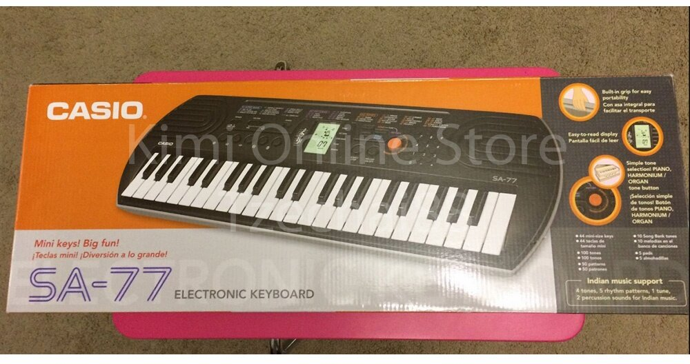 44 Key Casio SA-77 Orange Mini Electronic Keyboard Piano Organ LCD 8 Note Polyphony 100 Tones 50 Patterns 10 Song One Touch Switch
